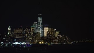 AX67_0065 - Aerial stock footage of 4K stock video aerial view of World Trade Center skyscrapers seen from the Hudson River at night, New York City