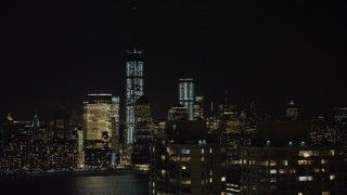 AX67_0069 - Aerial stock footage of 4K stock video aerial view of World Trade Center and Freedom Tower at night, New York