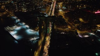 AX67_0078 - Aerial stock footage of 4K stock video aerial view of flying by Brooklyn Bridge at night, New York
