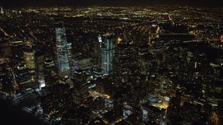 AX67_0085 - Aerial stock footage of 4K stock video aerial view of orbiting tall skyscrapers in Lower Manhattan and the World Trade Center at night, New York