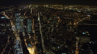 AX67_0095 - Aerial stock footage of 4K stock video aerial view of the south end of Lower Manhattan at night, New York