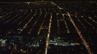 AX67_0104 - Aerial stock footage of 4K stock video aerial view of flying over apartment buildings and reveal hospital in Brooklyn at night, New York