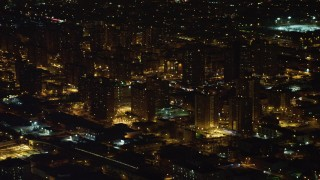 AX67_0106 - Aerial stock footage of 4K stock video aerial view of flying by Brooklyn projects at night, New York