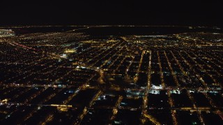 AX67_0107 - Aerial stock footage of 4K stock video aerial view of flying by Brooklyn at night, New York