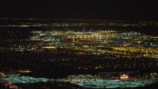 AX67_0108 - Aerial stock footage of 4K stock video aerial view of flying by John F. Kennedy International Airport at night, New York