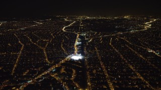 AX67_0110 - Aerial stock footage of 4K stock video aerial view of following train tracks in Queens at night, New York