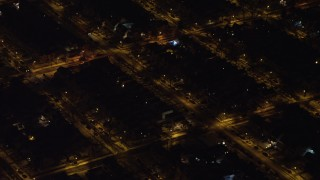 AX67_0111 - Aerial stock footage of 4K stock video aerial view of flying by residential neighborhoods in Queens at night, New York