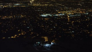 AX67_0113 - Aerial stock footage of 4K stock video aerial view of flying over urban residential neighborhoods in Queens at night, New York
