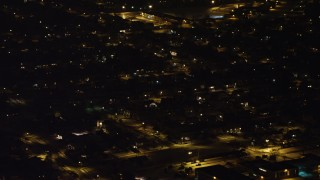 AX67_0118 - Aerial stock footage of 4K stock video aerial view orbiting a suburban neighborhood in Levittown at night, Long Island, New York