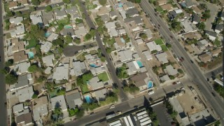 AX68_002 - 5K stock footage aerial video bird's eye view of suburban homes, revealing I-5 and street intersection in Sun Valley, California
