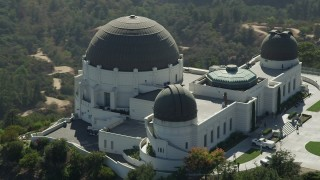 AX68_007 - 5K stock footage aerial video flyby the east side of Griffith Observatory in Los Angeles, California