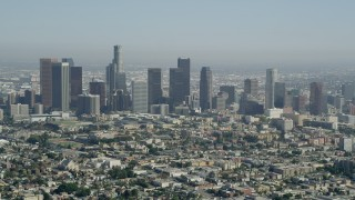 AX68_010 - Aerial stock footage of 5K stock aerial footage video tilt from Westlake apartment buildings to reveal Downtown Los Angeles, California