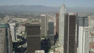 AX68_023 - 5K stock footage aerial video fly between City National Plaza and Aon Center to approach US Bank Tower in Downtown Los Angeles, California