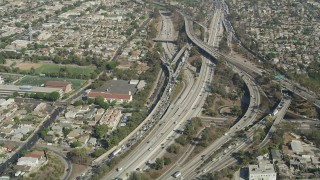 AX68_028 - 5K stock footage aerial video of heavy traffic on the East Los Angeles Interchange in Boyle Heights, Los Angeles, California