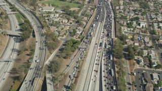AX68_030 - 5K stock footage aerial video fly over heavy traffic on Interstate 5 through Boyle Heights, Los Angeles, California