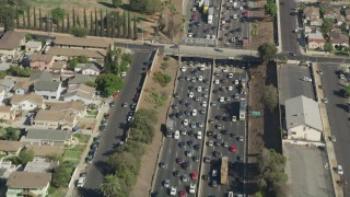 AX68_032 - 5K stock footage aerial video of a bird's eye view of heavy freeway traffic on Interstate 5 in Boyle Heights, Los Angeles, California