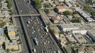 AX68_034 - 5K stock footage aerial video of traffic on Interstate 5 through East Los Angeles, California