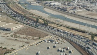 AX68_036 - 5K stock footage aerial video of heavy traffic on a bend in I-710 by the Los Angeles River in Vernon, Los Angeles, California