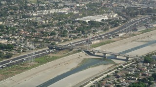 AX68_038 - 5K stock footage aerial video approach the Los Angeles River and Interstate 710 in Bell Gardens, Los Angeles, California