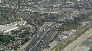 AX68_039 - 5K stock footage aerial video approach traffic backing up on Interstate 710 in Bell Gardens, Los Angeles, California