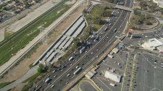 AX68_041 - 5K stock footage aerial video of reverse bird's eye view of traffic on Interstate 710 in Bell Gardens, Los Angeles, California