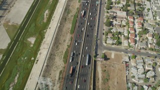 AX68_042 - 5K stock footage aerial video of reverse bird's eye view of light traffic on Interstate 710 through Bell Gardens, Los Angeles, California