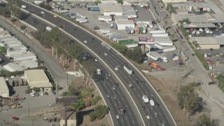 AX68_044 - 5K stock footage aerial video of light traffic on I-710 crossing the Los Angeles River in South Gate, Los Angeles, California