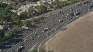 AX68_045 - 5K stock footage aerial video of light traffic on Interstate 710 through South Gate, Los Angeles, California