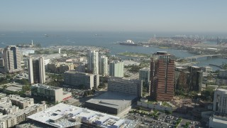 AX68_050 - 5K stock footage aerial video tilt to reveal office buildings in Downtown Long Beach and the Queen Mary, California