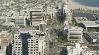AX68_057 - 5K stock footage aerial video of Ocean Boulevard lined with office buildings by Westin Long Beach in Downtown Long Beach, California