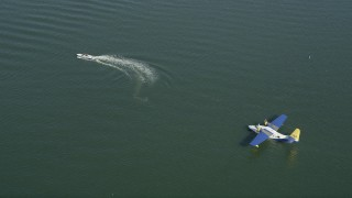 AX68_062 - 5K stock footage aerial video of speedboat and a seaplane in San Pedro Bay, Long Beach, California