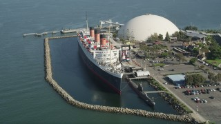 AX68_064 - 5K stock footage aerial video tilt to reveal the Queen Mary Docked in Long Beach, California