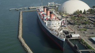 AX68_065 - 5K stock footage aerial video of passing the starboard side of the Queen Mary luxury liner in Long Beach, California