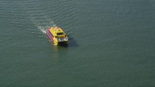 AX68_074 - 5K stock footage aerial video of ferry slowly sailing across San Pedro Bay, Long Beach, California