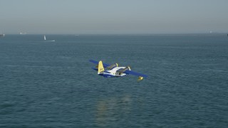 AX68_078 - 5K stock footage aerial video track seaplane flying over San Pedro Bay in Long Beach, California
