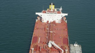 AX68_081 - 5K stock footage aerial video fly over the deck of an oil tanker anchored in San Pedro Bay, Long Beach, California