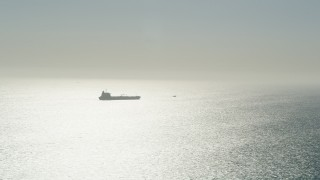 AX68_083 - 5K stock footage aerial video of an oil tanker sailing the Pacific Ocean