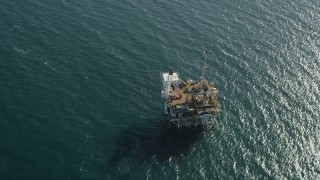 AX68_102 - 5K stock footage aerial video of bird's eye view of an oceanic oil platform off the California Coast near Long Beach