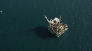 AX68_103 - 5K stock footage aerial video of bird's eye of an oil drilling platform near the California Coast, Long Beach