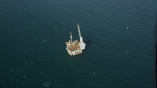 AX68_104 - 5K stock footage aerial video of a bird's eye of an oceanic oil platform near Long Beach, off the California Coast