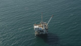 AX68_106 - 5K stock footage aerial video of flyby an oil platform just off the California Coast, Long Beach