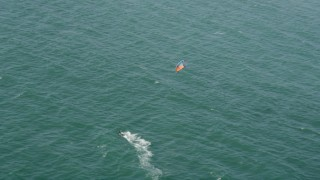 AX68_118 - 5K stock footage aerial video track a kite surfer in San Pedro Bay, Long Beach, California