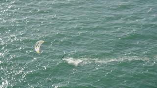 AX68_119 - 5K stock footage aerial video of tracking a kite surfer cruising across San Pedro Bay, Long Beach, California