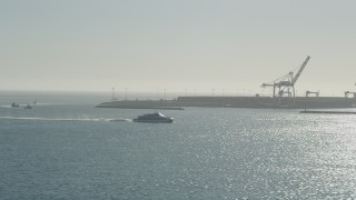 AX68_131 - 5K stock footage aerial video of a ferry sailing across San Pedro Bay in Long Beach, California