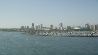 AX68_134 - 5K stock footage aerial video of Shoreline Marina and Downtown Long Beach skyline, California