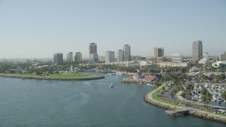 AX68_135 - 5K stock footage aerial video pass Shoreline Marina and village to approach Rainbow Harbor and Downtown Long Beach skyline, California