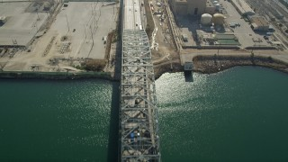 AX68_141 - 5K stock footage aerial video fly over Gerald Desmond Bridge at the Port of Long Beach, California