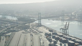 AX68_146 - 5K stock footage aerial video approach the Vincent Thomas Bridge with light traffic at Port of Los Angeles, California