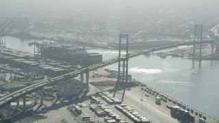 AX68_147 - 5K stock footage aerial video of light traffic crossing the Vincent Thomas Bridge in Port of Los Angeles, California