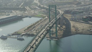 AX68_149 - 5K stock footage aerial video fly over the Vincent Thomas Bridge at the Port of Los Angeles, California
